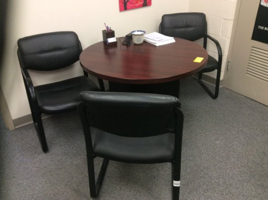 Round table and three chairs