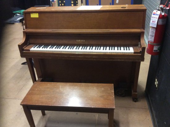Yamaha piano with bench