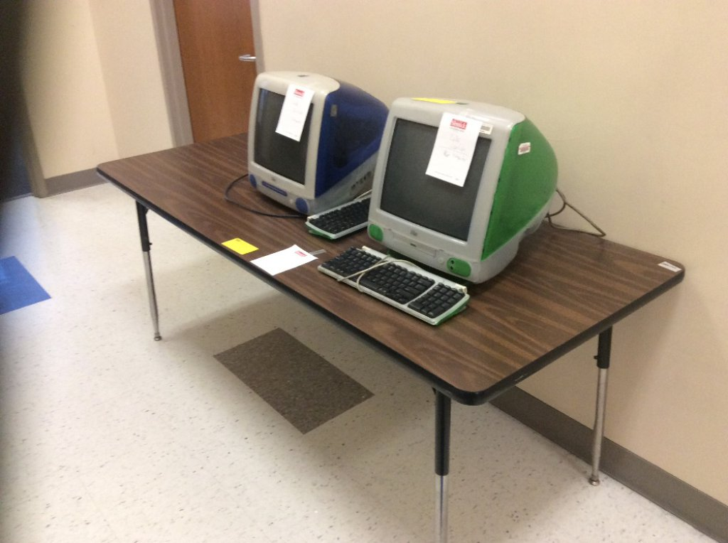 Two tables and 2 iMac computers