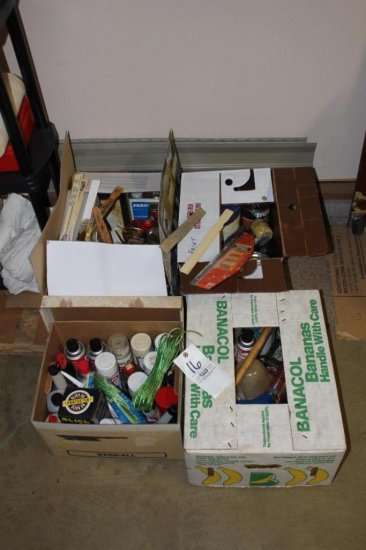 Assorted painting supplies including spray paints