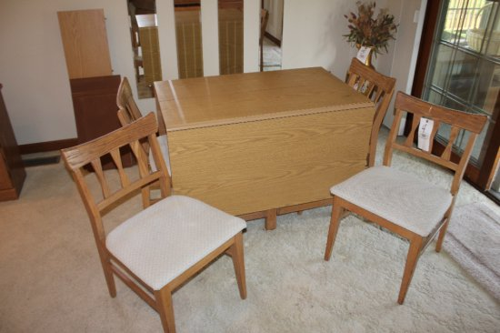 Long drop-leaf table w/ extra leaf, (6) padded chairs & table pads