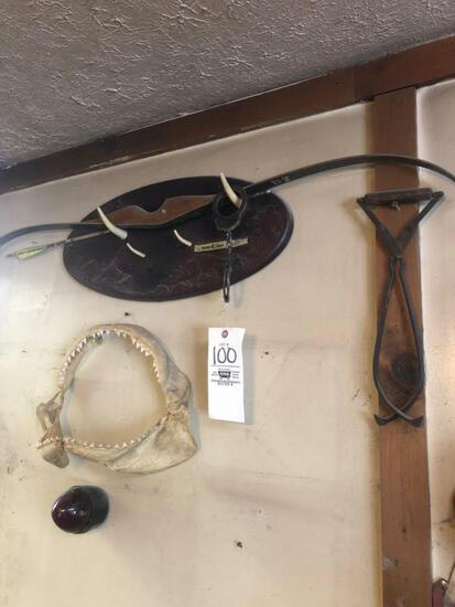 Recurve bow, jaws, and hand cuff.