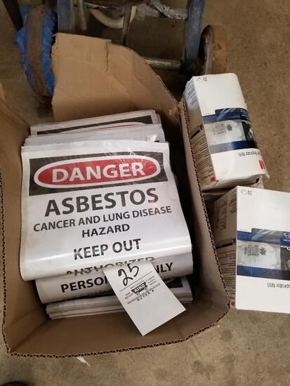 Box of danger signs and 4 boxes of respirators
