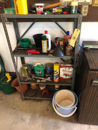 Shelf, contents and garden hose