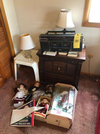 Nightstand, radio and dolls