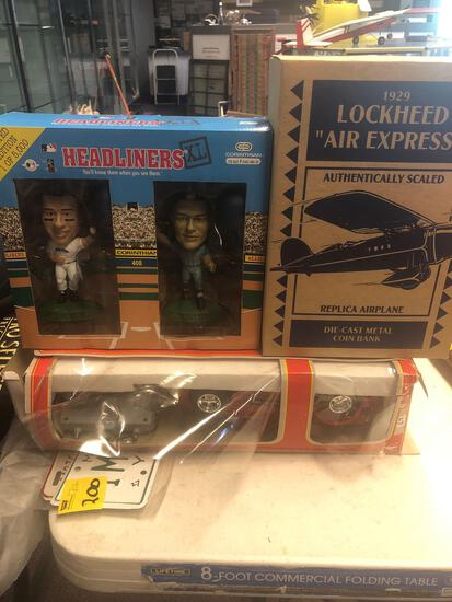 Diecast replica airplane, metal coin bank, headliner bobble heads, diecast vehicles