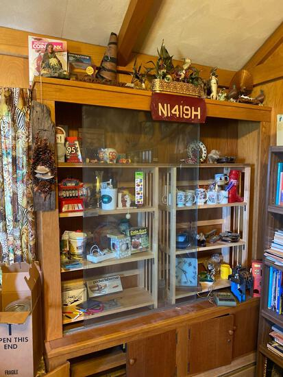 Contents of glass display cabinet, Las Vegas items, coffee mugs, bird clock, belt buckle, ashtrays