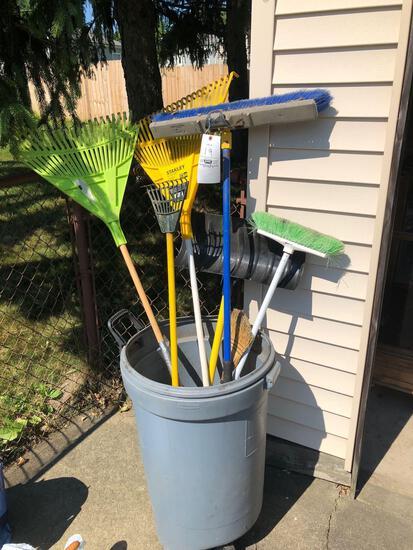 Trash can and yard tools