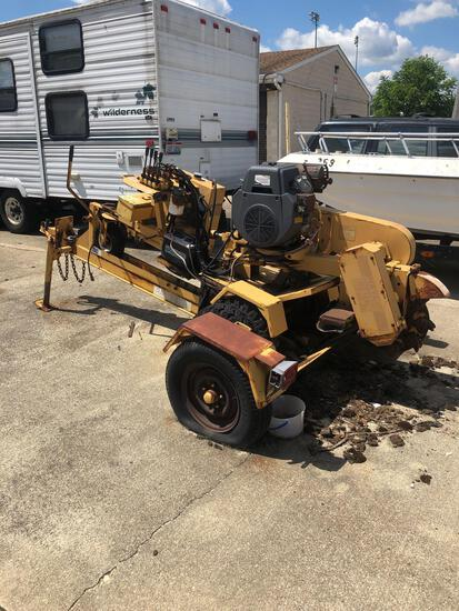 Rayco RG 1625 stump grinder on trailer