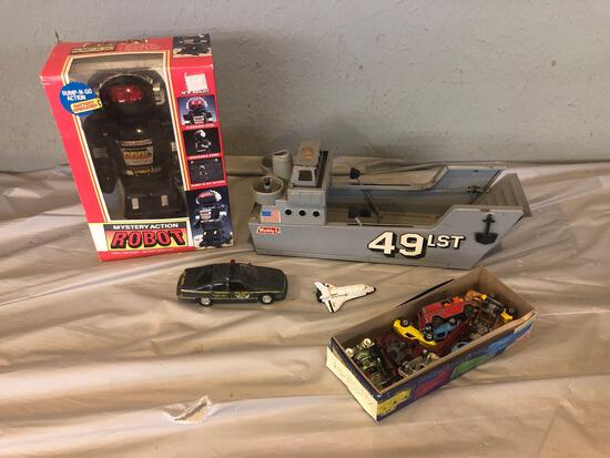 Tootsie toys, Buddy L ship, Mystery Action robot, Diecast highway patrol and spaceship