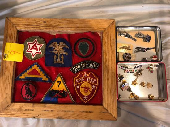 Framed military badges, railroad pins and tie clip