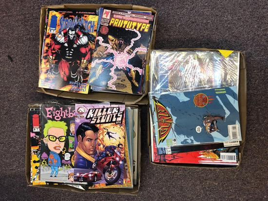 Three flats of comic books including Killer Stunts, Storm Witch, Blaze and others