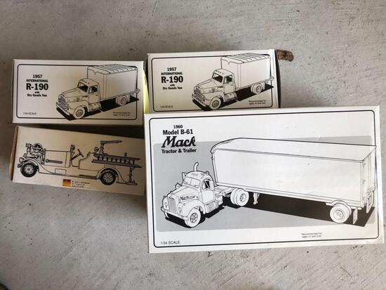 Four diecast toy trucks.