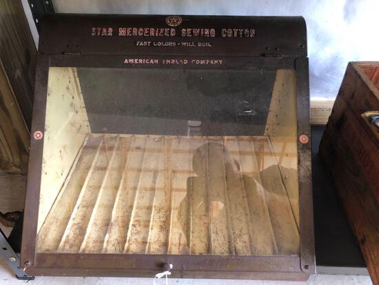 Metal cotton sewing display.
