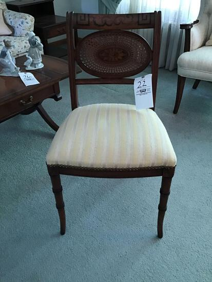 Stenciled and cane-back chair with nail head trim