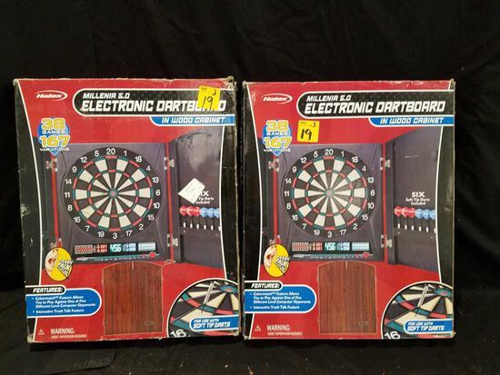 Pair of Halex millenia 5.0 electronic dartboard in wood cabinet
