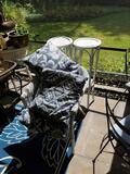 Wicker chair, pillows, fern stands