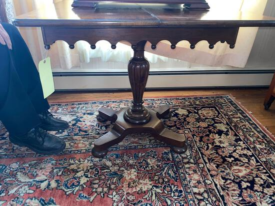 Antique swivel top walnut pedestal game table