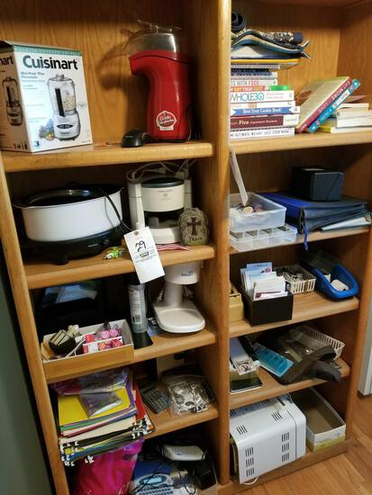 Contents of shelf incl. appliances, books, calculators