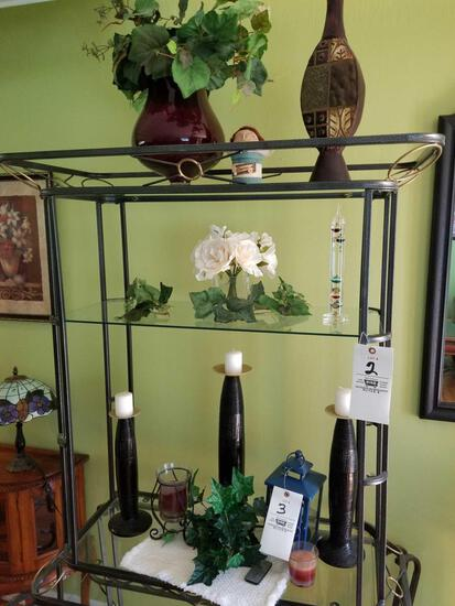 Contents of rack including lantern, vases, decor
