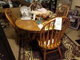 Solid oak table with 4 chairs, 2 extra leaves