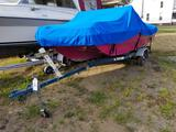 1973 MFG 15 ft. boat with trailer and 1973 Evinrude 65 outboard motor and trailer