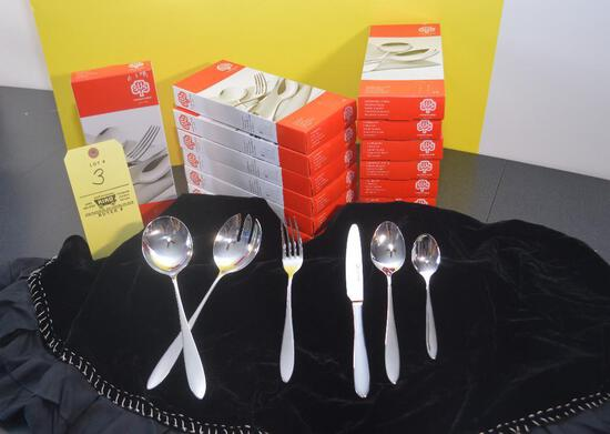 12 Four piece Schulte-Ufer silverware sets and two salad serving sets