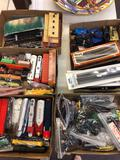 5 flats of HO train cars, track, accessories, engines, etc