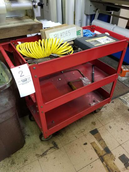 Red tool cart with tools