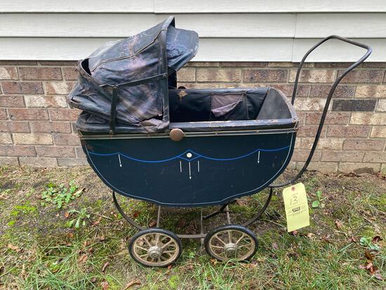 "Antique doll stroller, 32"" long, shows wear."