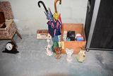 Stemware, light bulbs include LED, figurines, umbrellas and vase.