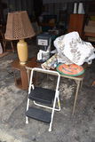 Bunn Coffee maker, holiday items, Throw, Costco step stool, Lamp and Stand.
