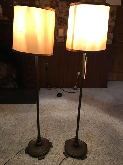Matching pair of metal floor lamps