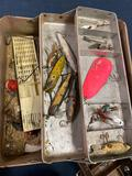 3 filled tackle boxes