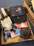 Old comics, Atari controller, and toys