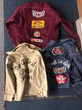 Child?s car racing jackets, automotive racing club of America patches, etc.