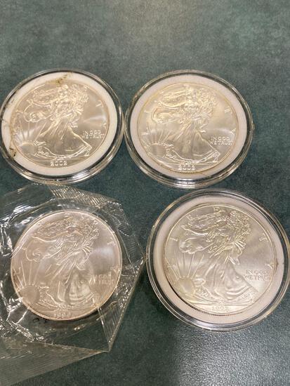 (4) Silver American Eagle coins, each one ounce of .999 fine silver. Bid times four. (1994, 1998, &