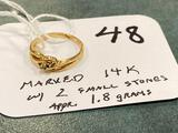 Marked 14K ring w/ two small stones, 1.8 grams approximately.