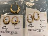 All gold earrings, 2 pairs marked 10K, single marked 14K.