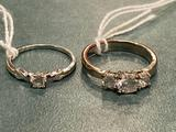 (2) Unmarked rings. Stones are not diamonds.