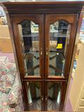 Cherry curio cabinet glass and lighted , great condition