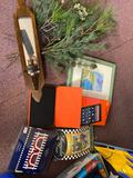 Kindle Fire hd10, tree greenery, glass with candle and shells, whole bin full of decorative outdoor