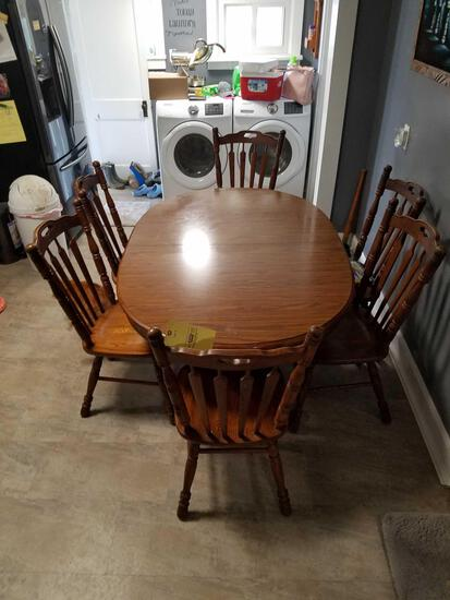 Tell city oak table with formica top, 2 extra leaves and 6 oak chairs