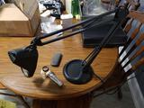 Magnifying desk lamp, hand magnifier and eye glasses