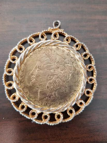 1879 Morgan silver dollar in necklace case