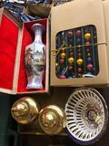 Garland, brass jars, etc