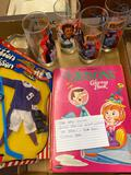 Star Wars glasses, action Jackson hockey uniform, the Jetsons and Speed Buggy coloring books