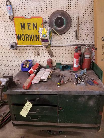 Workbench, vice, welding rod, helmet, hand tools