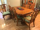 Very nice quality oak Carved dining table W/ 6 padded chairs And two extra leaves