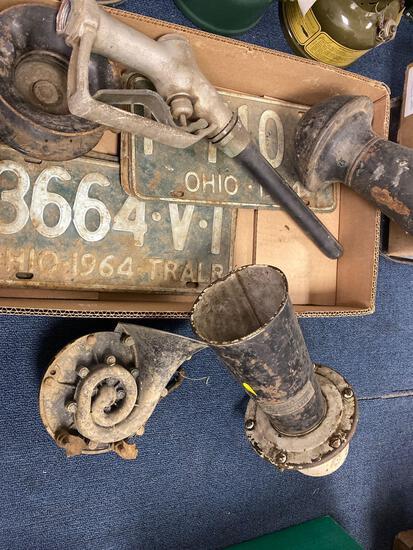 Vintage car horns, license plates, klaxon, lights?